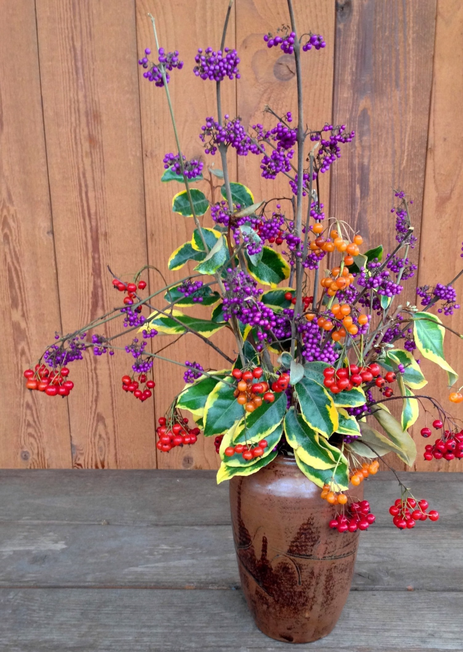 Fall vase: warm compliments of red, orange and yellow, with some cool purple relief. All are fall prunings from my yard.