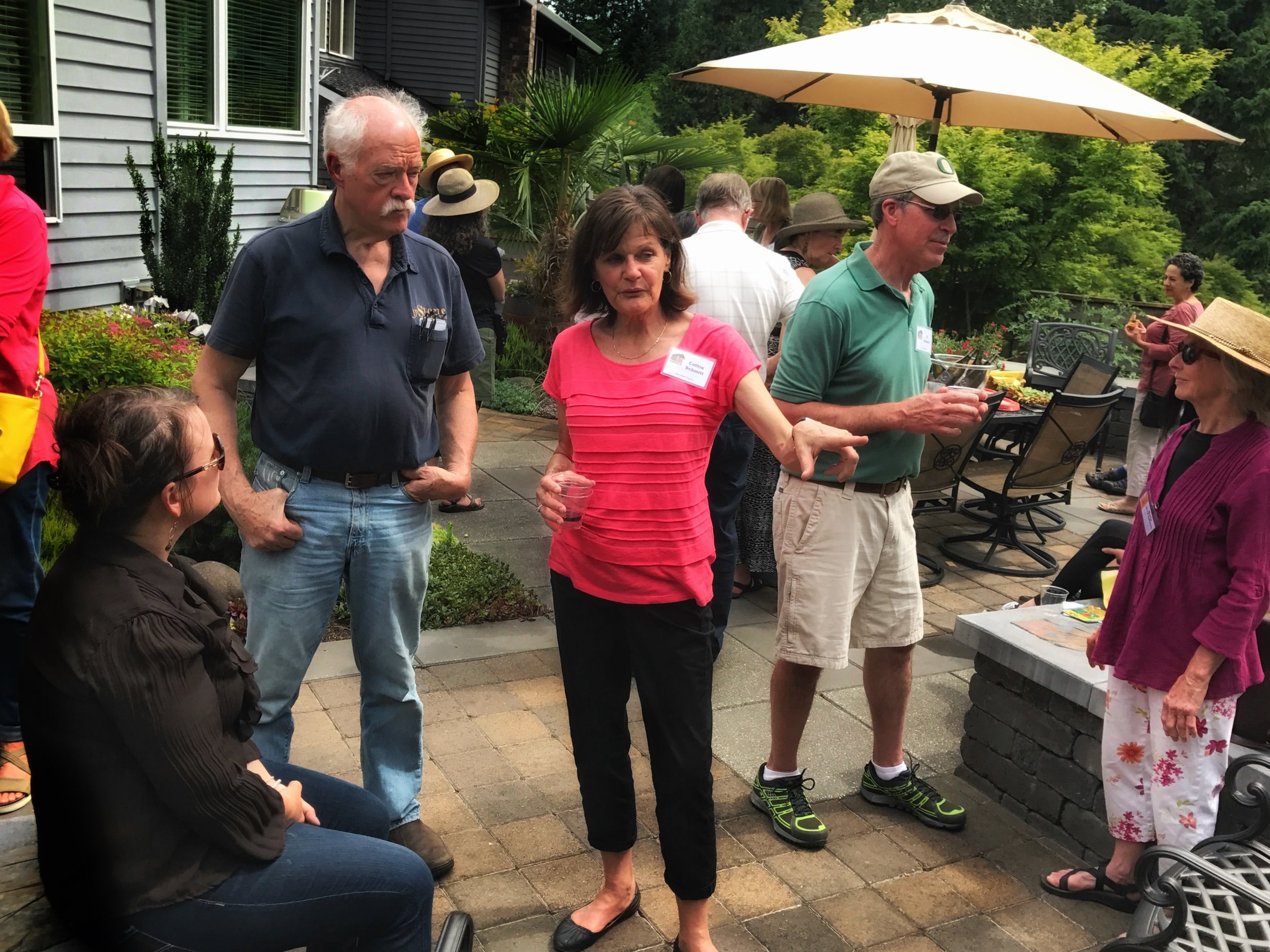 John Stone talking with homeowner Cathie Schmitt
