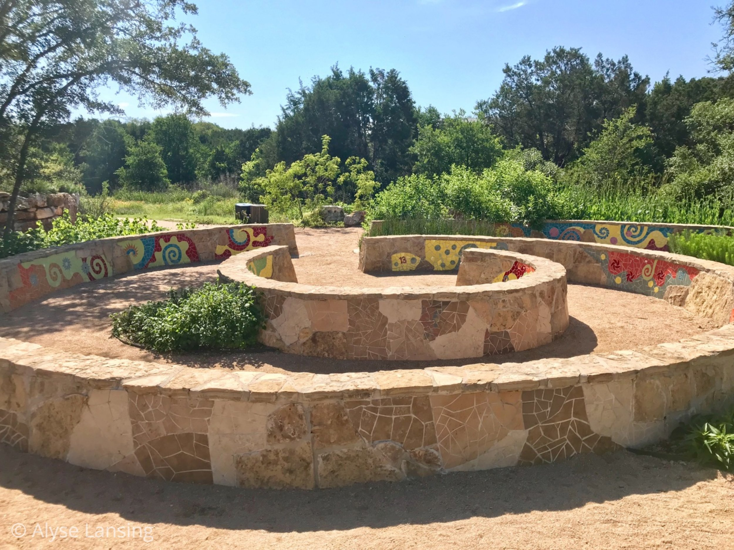 """First I came upon this mosaic wall, named """"Nature's Spiral,"""" that's fun to climb AND showcases the spirals of nature from sunflowers to shells to hurricanes."""