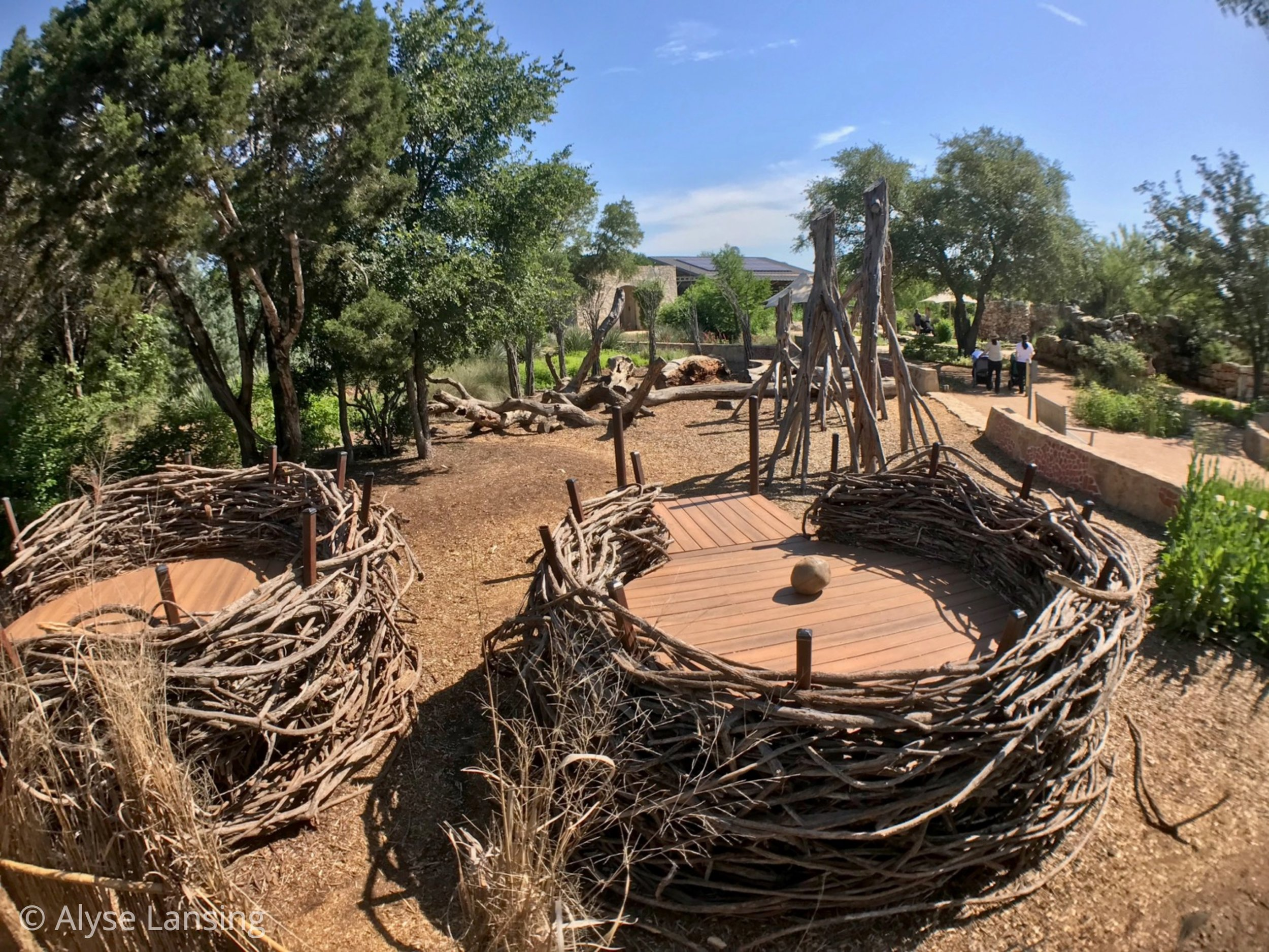 Birds nest play forts are as artistically/lovingly woven as a robin herself would do. This place is a little village of bird nest homes. Or forts, if you roll that way.