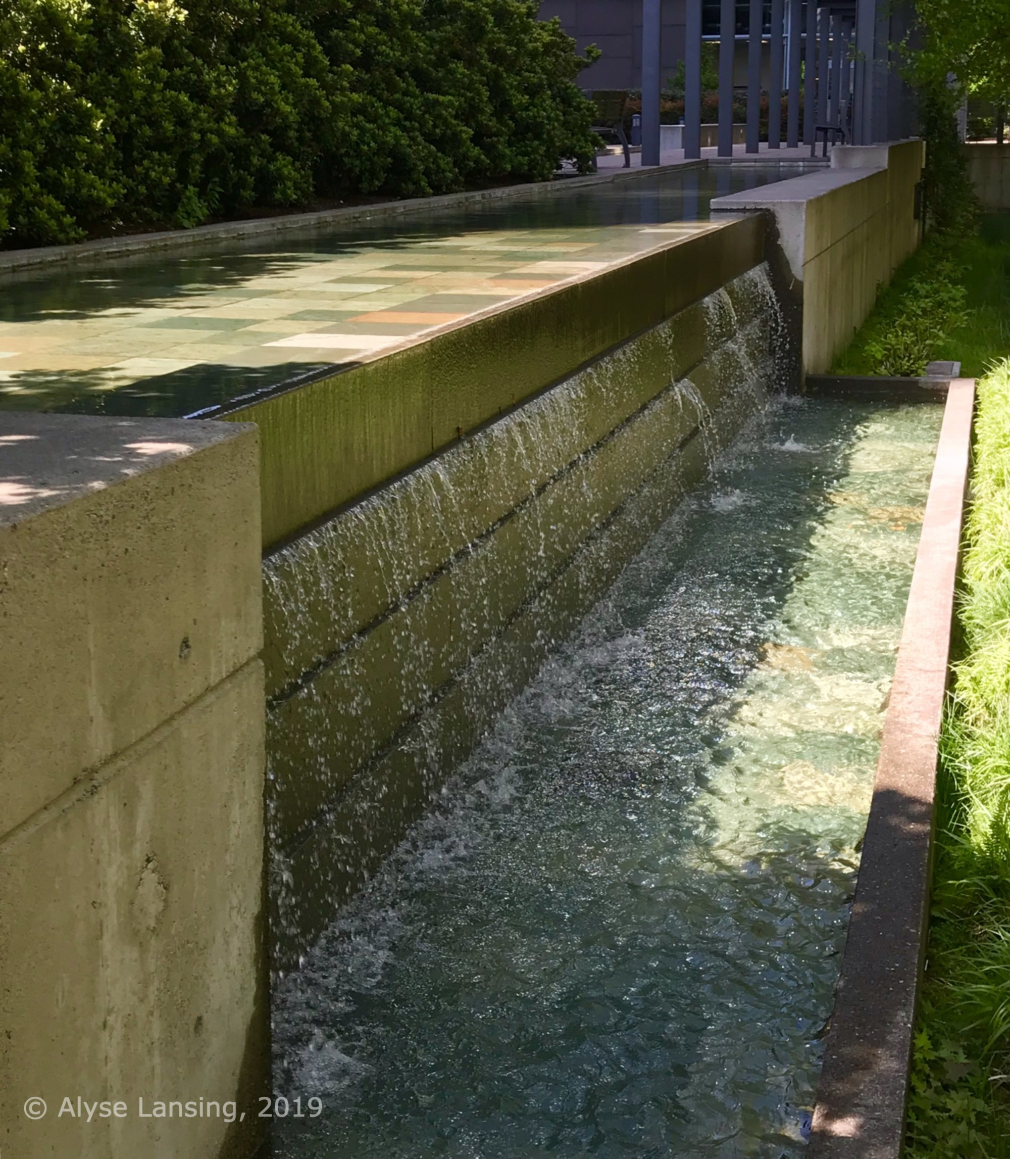 Handsome waterfalls outside the Atwater building, on the public walkway Pennoyer Street.
