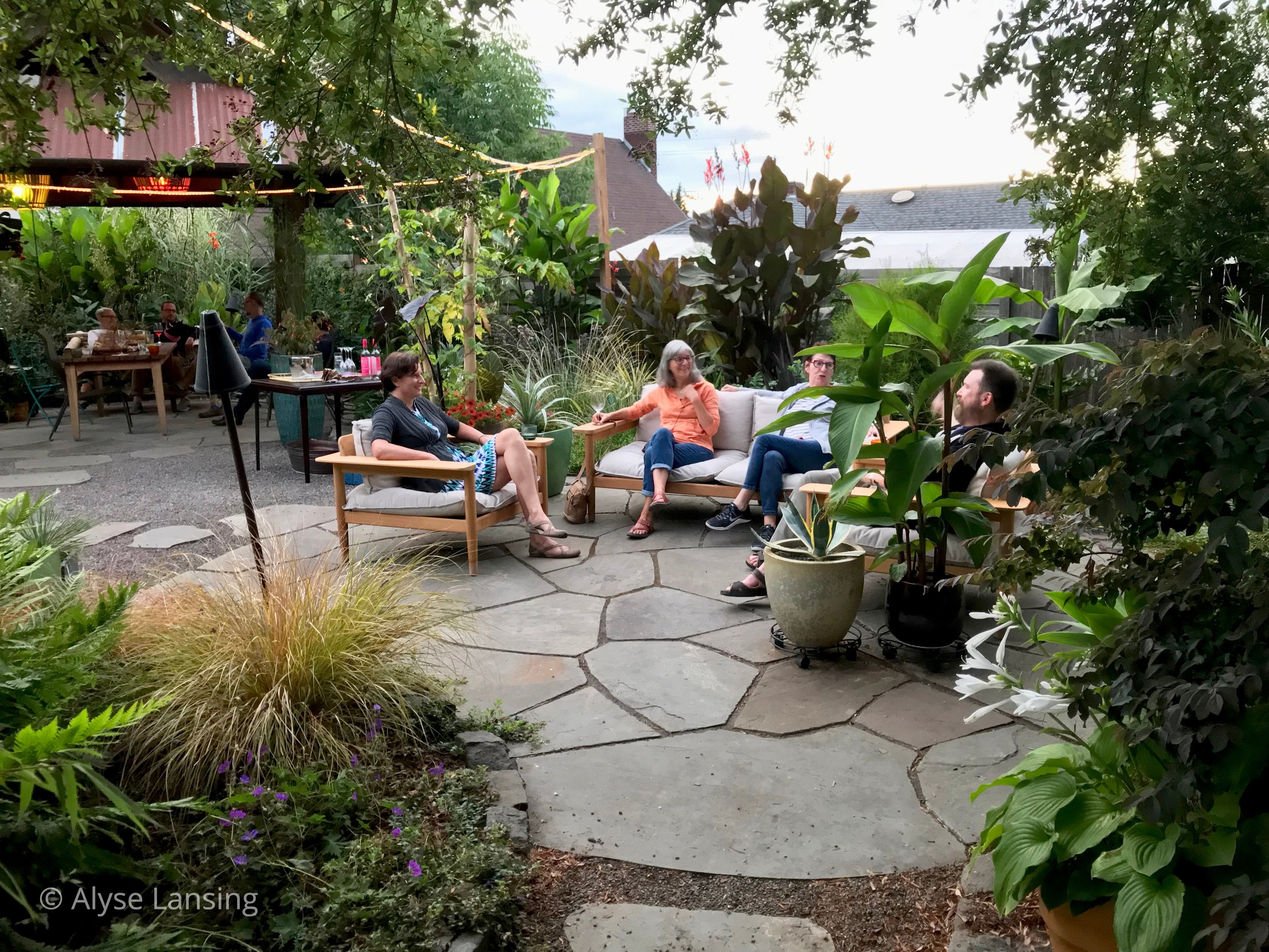 A few of Portland's garden bloggers relax in Heather & Greg's new back yard.