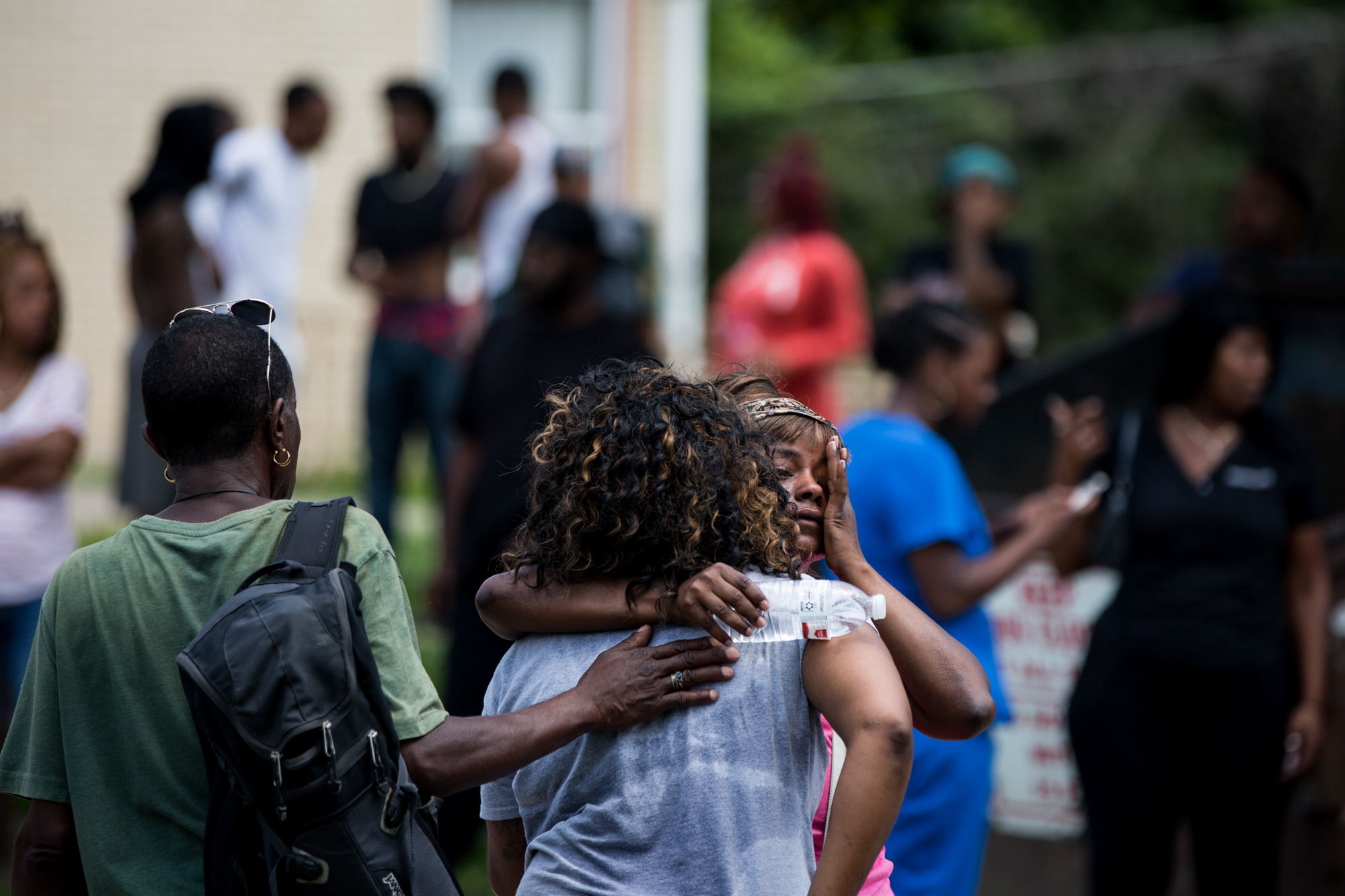 Neighbors and friends comfort each other at the scene of a shooting that killed two people on Tuesday, July 18, 2017 in Larimer, Pennsylvania.