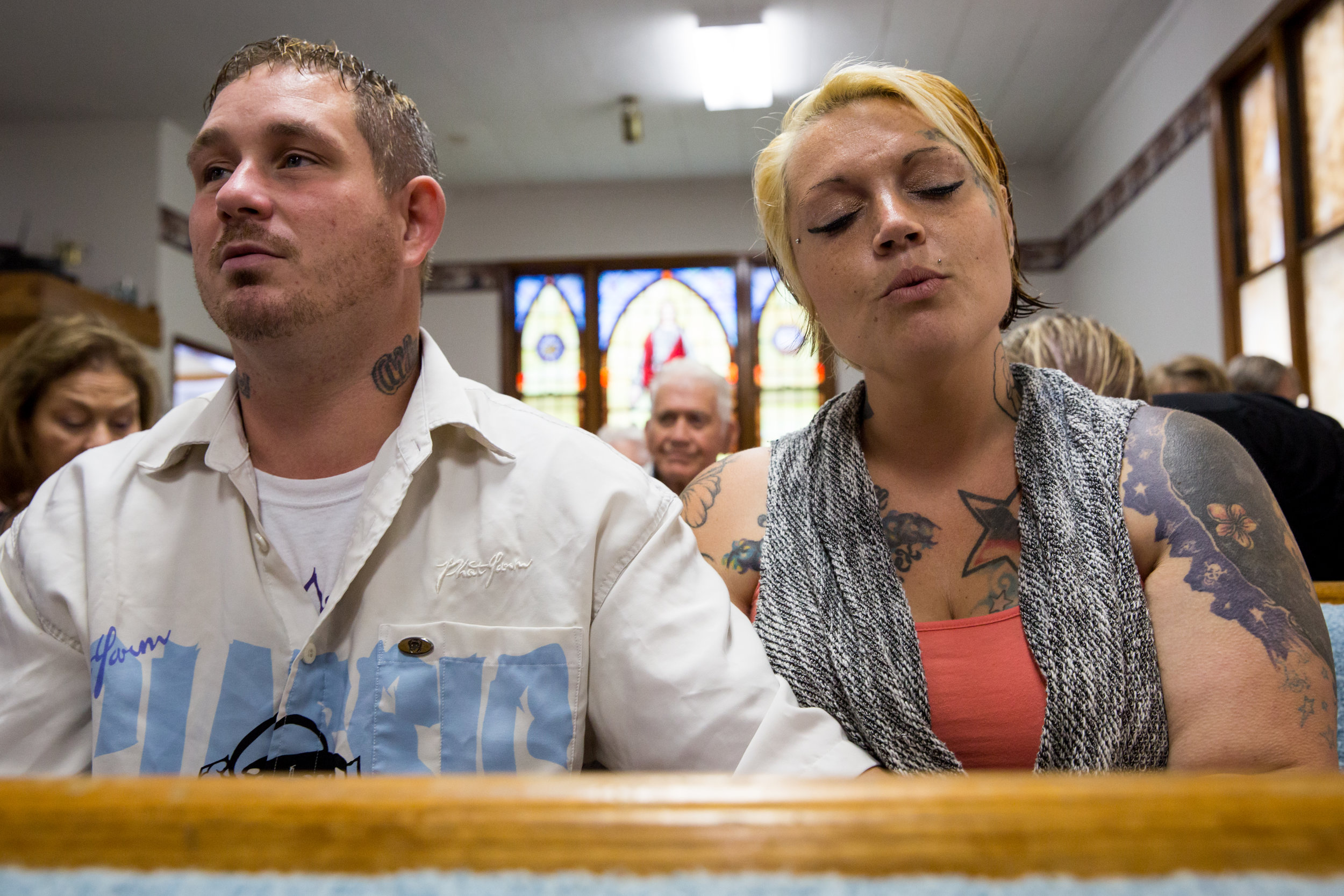Whitney and Jeremy sing along during a church service at Freedom Memorial Church in Logan. Whitney used to frequent the church but had a falling out with some of the members and had been going elsewhere for a few months.