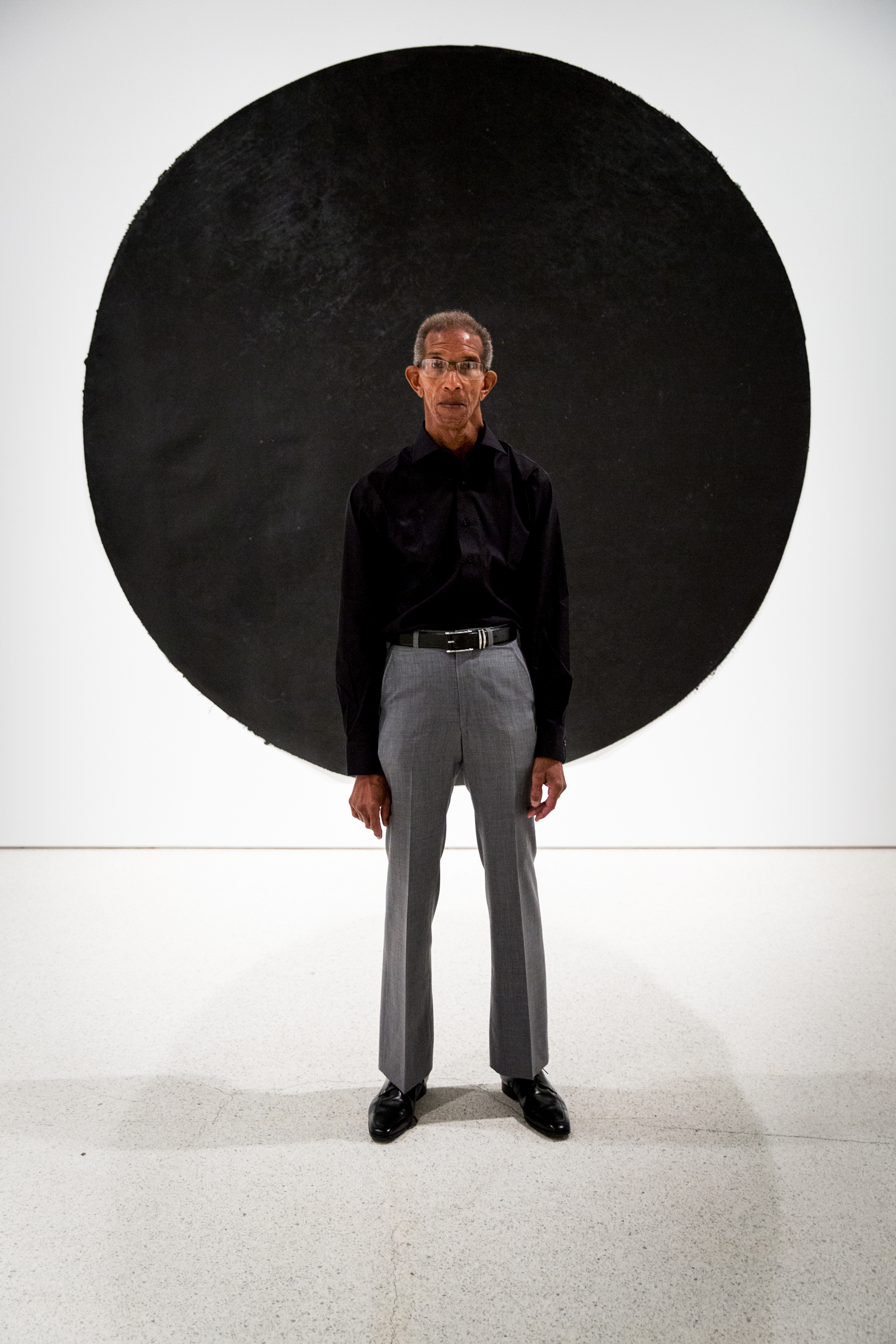 Quentin Morris poses for a portrait in front of his untitled painting during the grand opening of the 20/20 exhibition at the Carnegie Art Museum on Saturday, July 22, 2017 in Pittsburgh. The 20/20 exhibition is an exploration of race in America, and features work by many black artists from around the country.