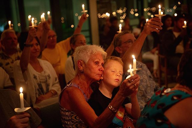 Ellen Vaughn holds her grandson Liam Owens, 9, during a vigil held at the Unitarian Universalist Congregation of Greater Naples for migrants in detention facilities on Friday, July 12. The vigil was one of many international events that made up Lights for Liberty: A Vigil to End Human Concentration Camps.