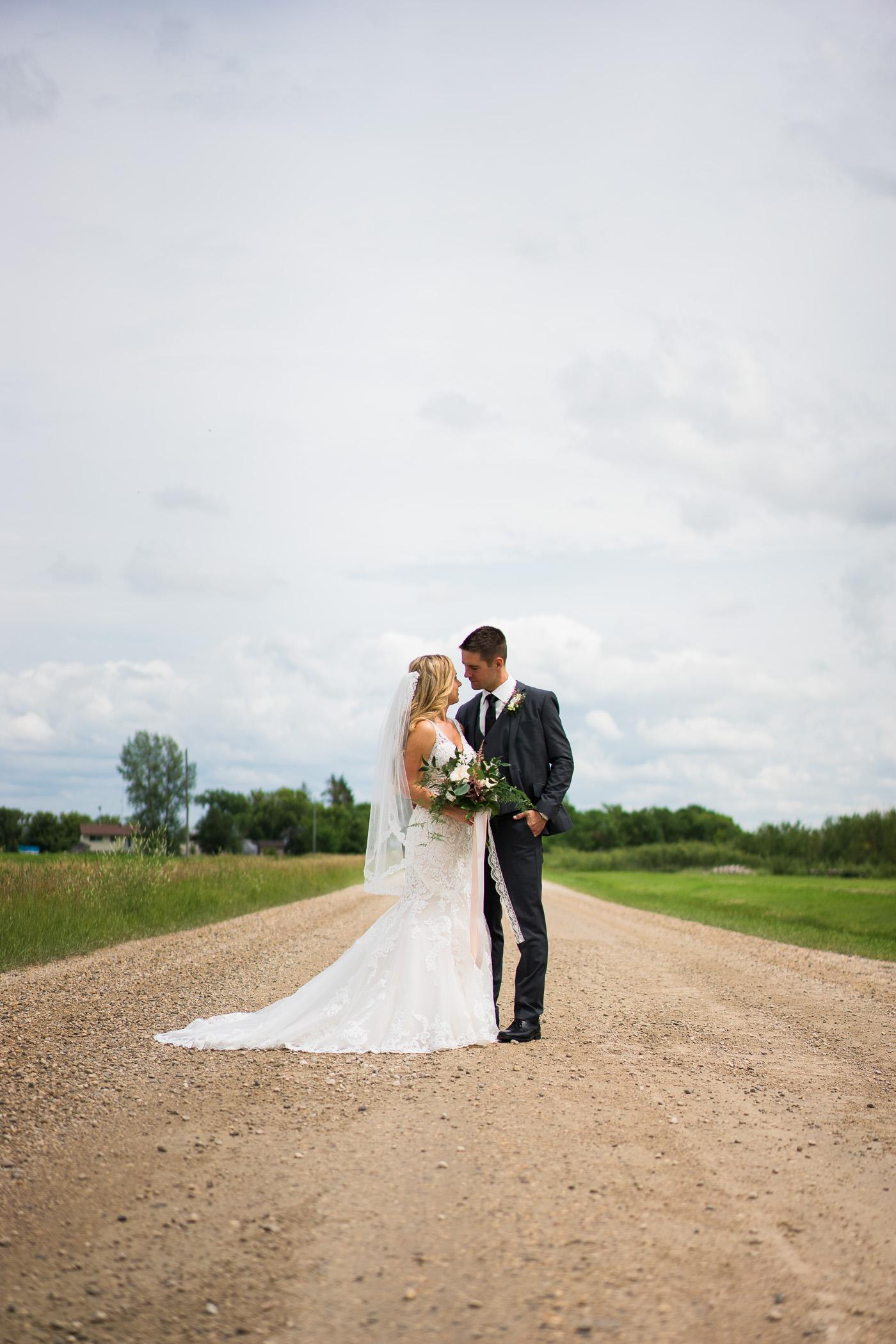 Kylie and Kevin - Steinbach Wedding - COJO Photo-1331.jpg