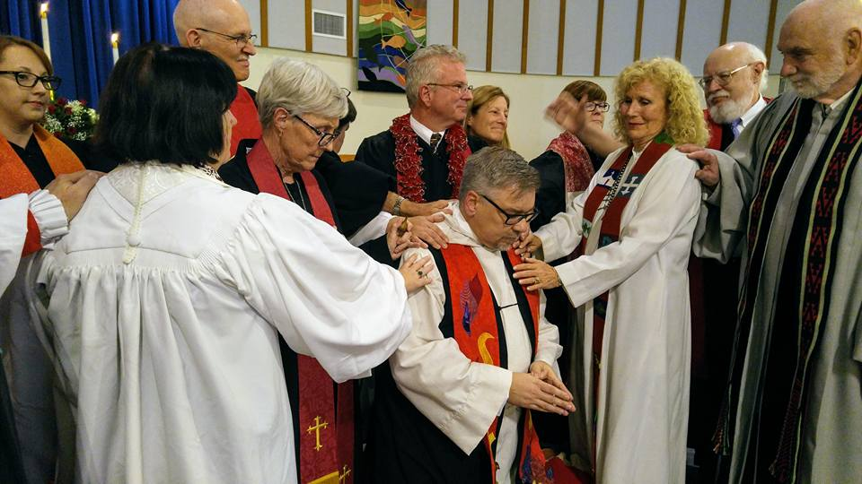 clergy laying on hands by erin tamayo.jpg
