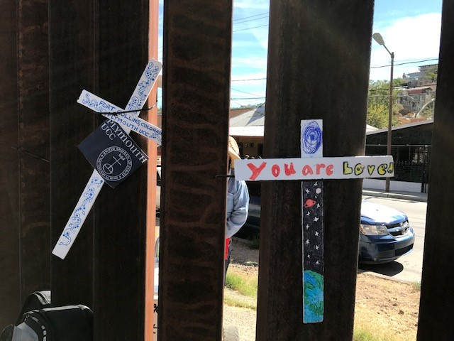 GSUCC Hanging crosses on the border wall during the SOA Watch Event.jpg