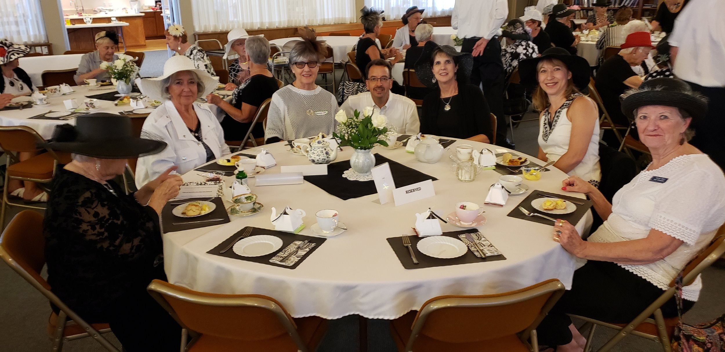 ladies black and white tea united church sun city.jpg