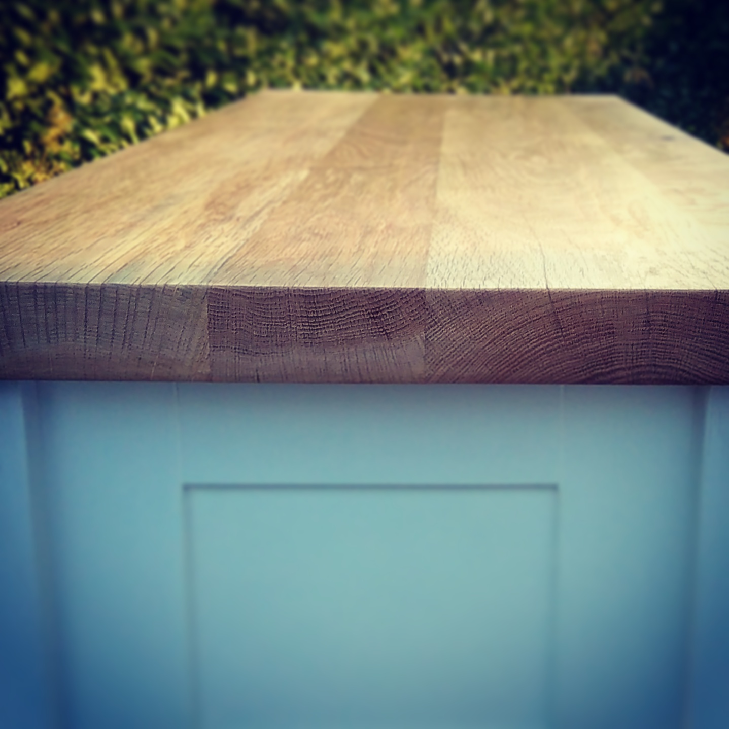 One of our wide plank reclaimed oak worktops, being used here as part of a freestanding kitchen for the scullery table.