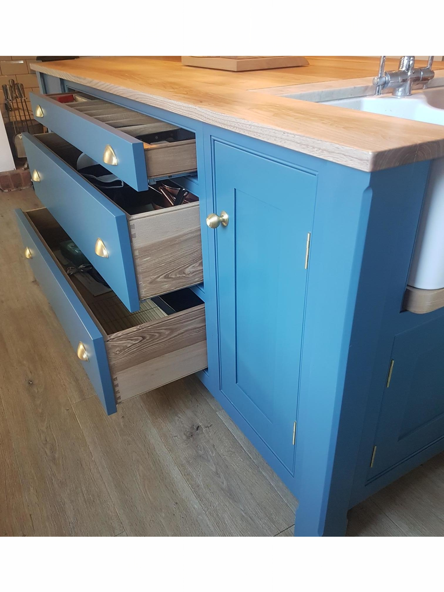 Drawers in a bespoke island unit, making the best of the available storage space.