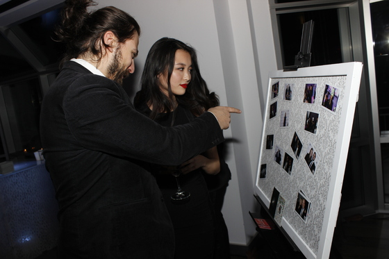 Guests finding their pic during the Classic Service