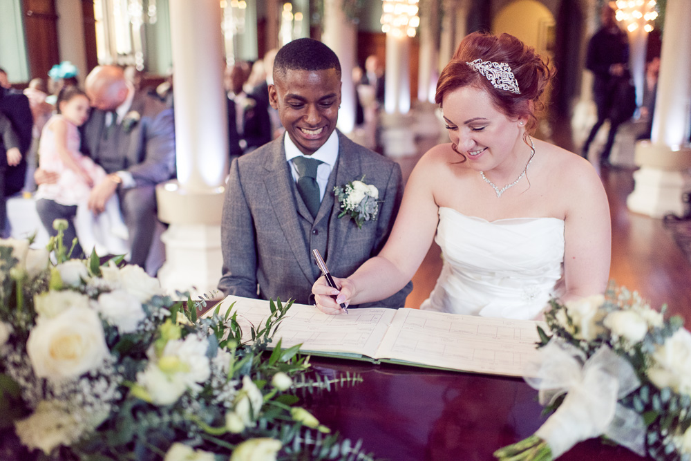 Monika and Conran Signing the Register