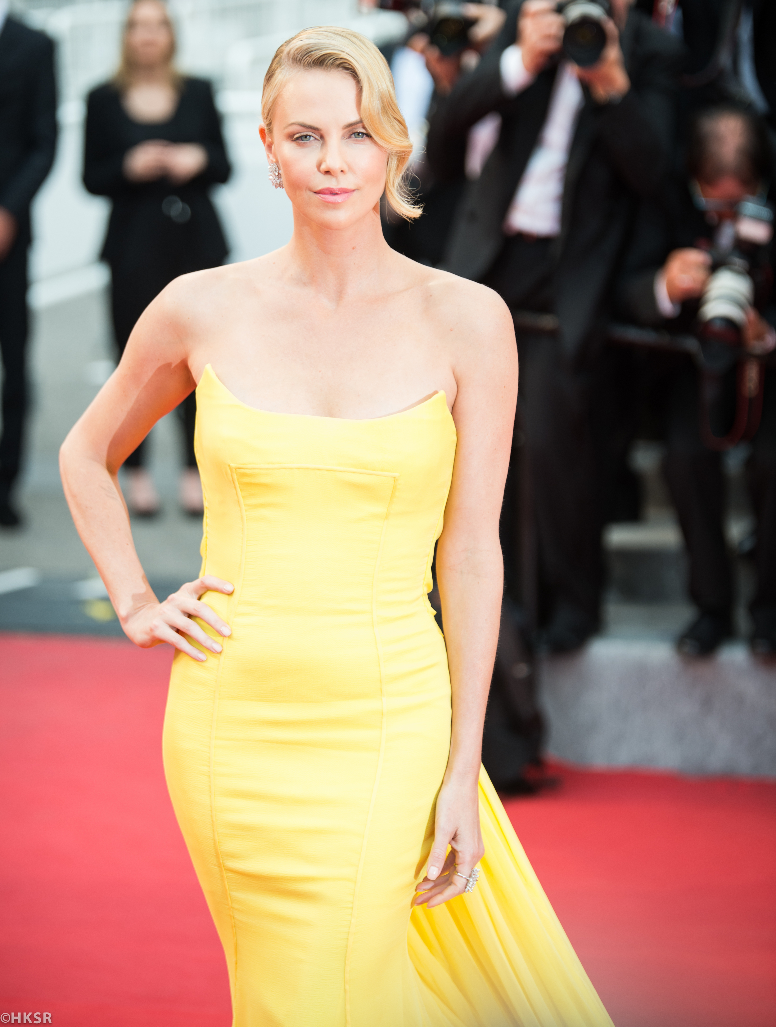 Charlize Theron looked stunning in her yellow Dior gown on the red carpet at Cannes 2015