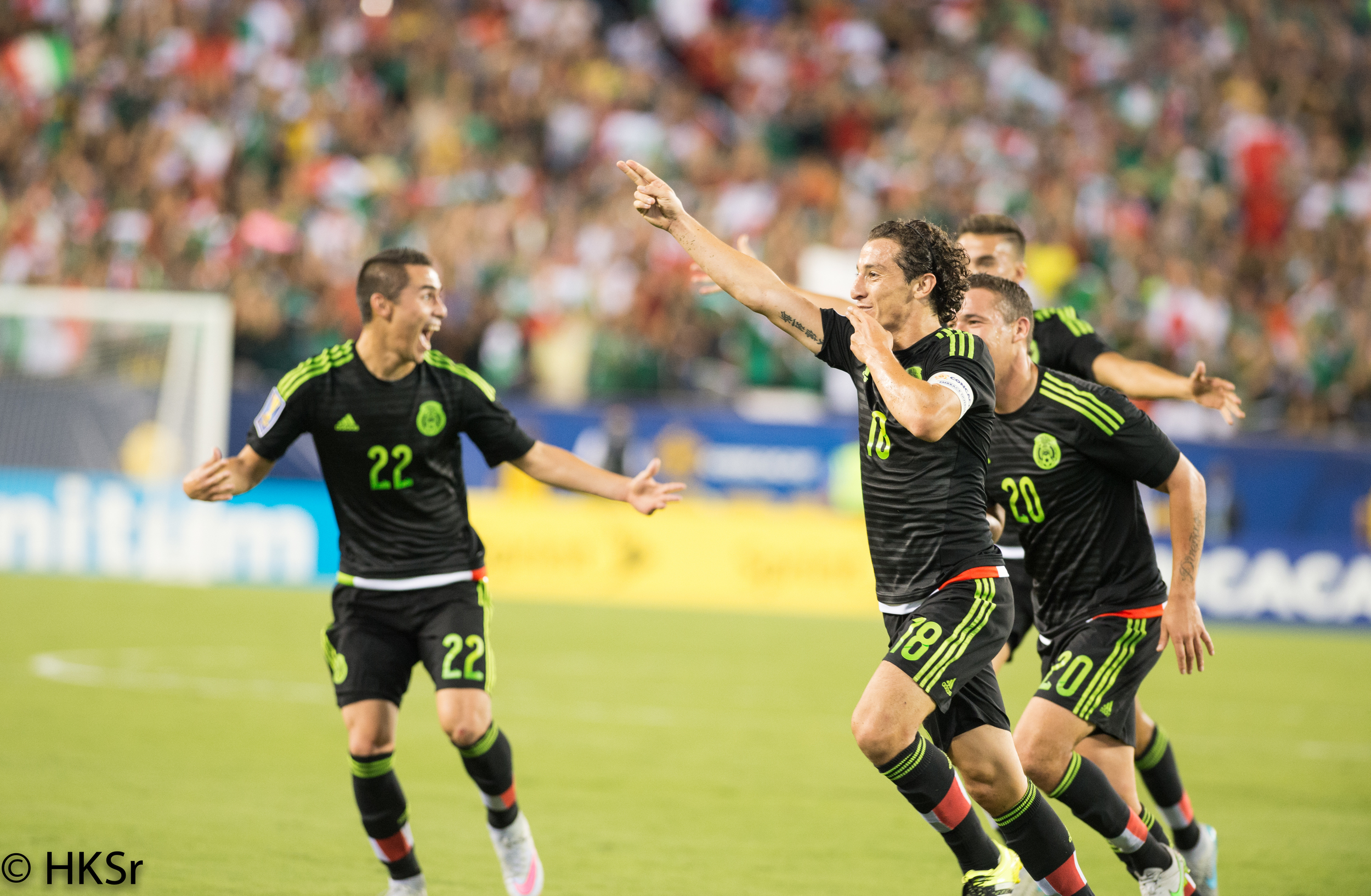 The first goal of the match by Mexico #18 Andres Guardado