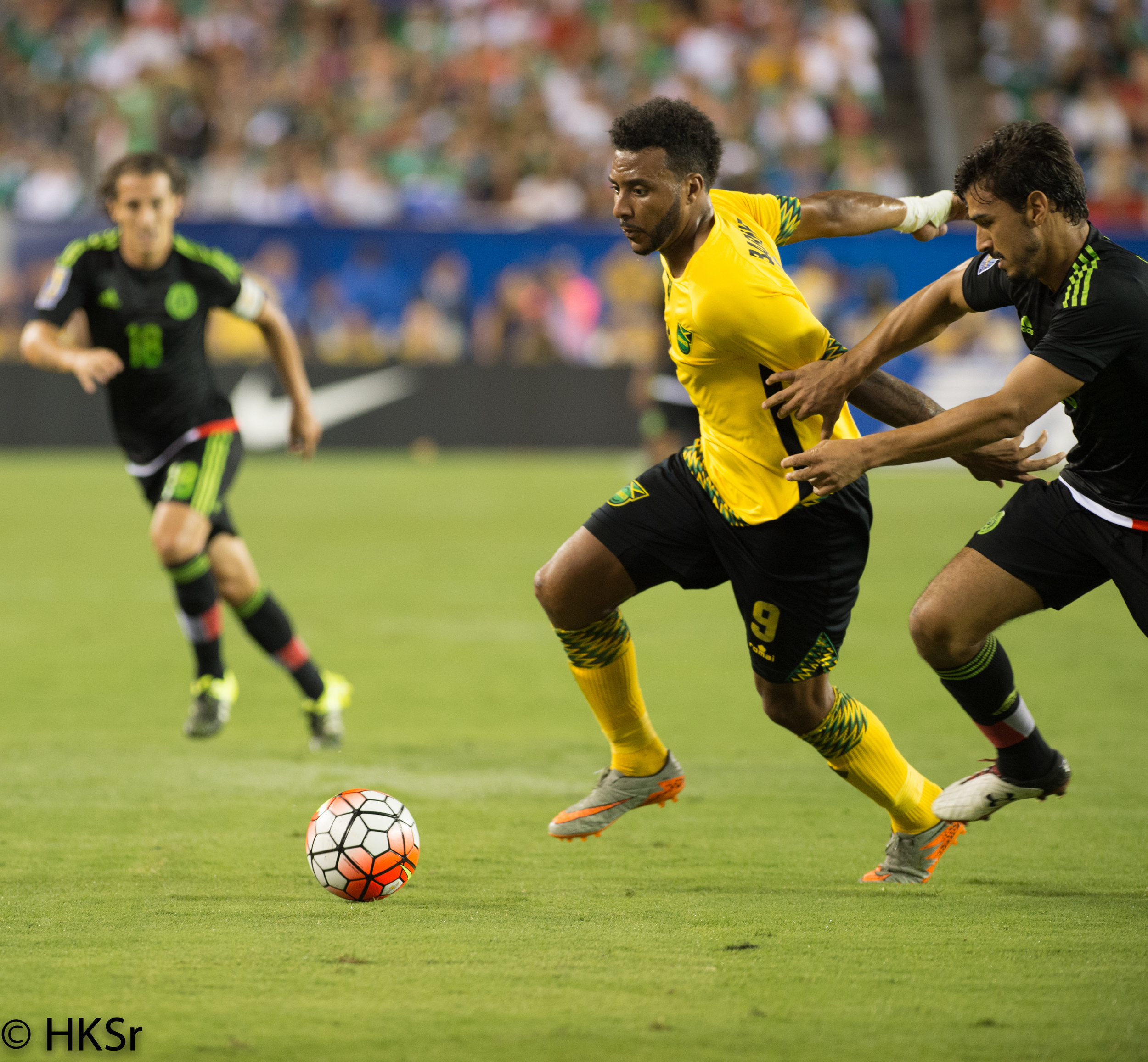 Jamaica #9 Giles Barnes holds off defender