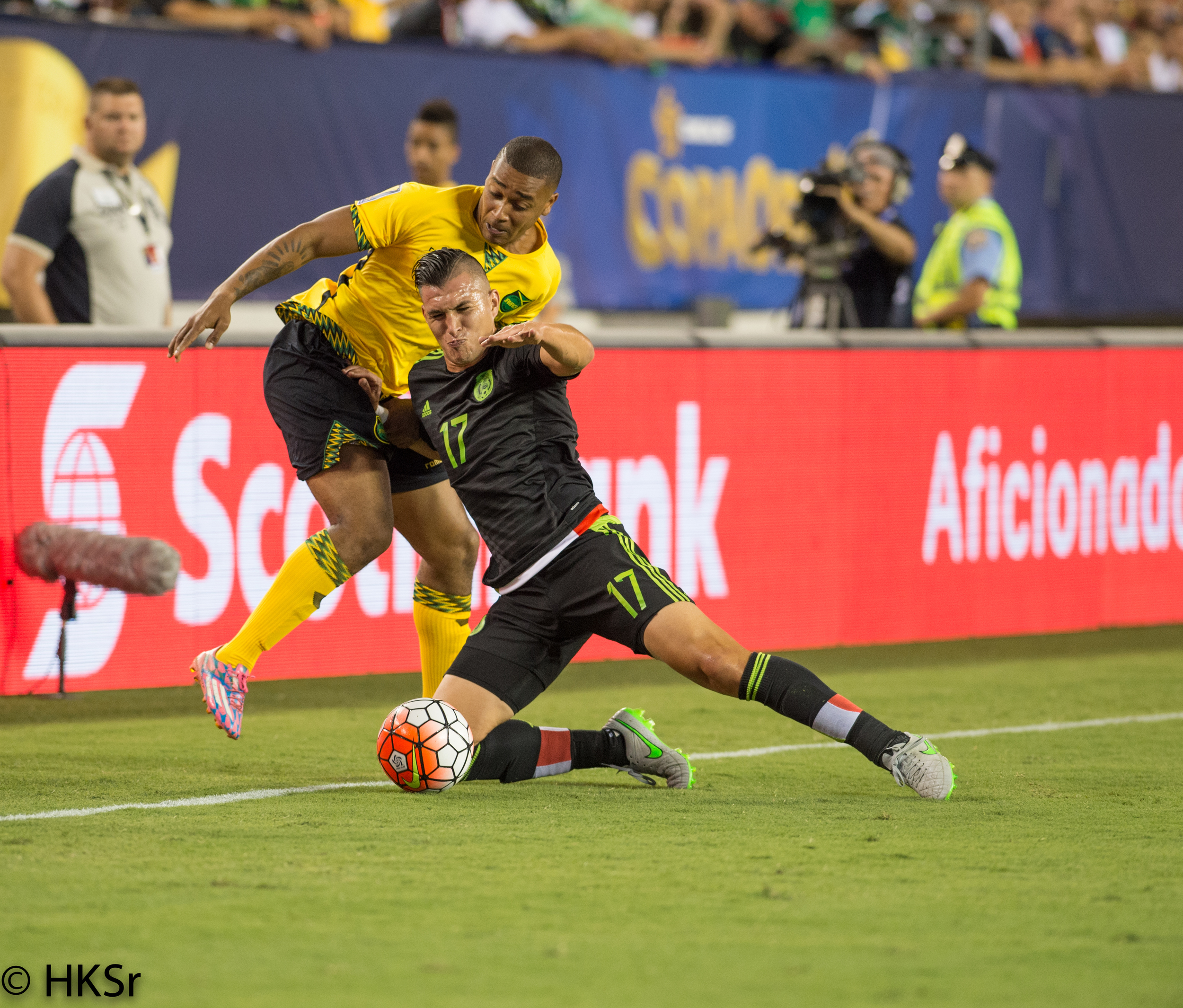 Mexico player #17 Jorge Torres Nilo fights off Jamaica player#2 Christopher Humphrey for ball position.