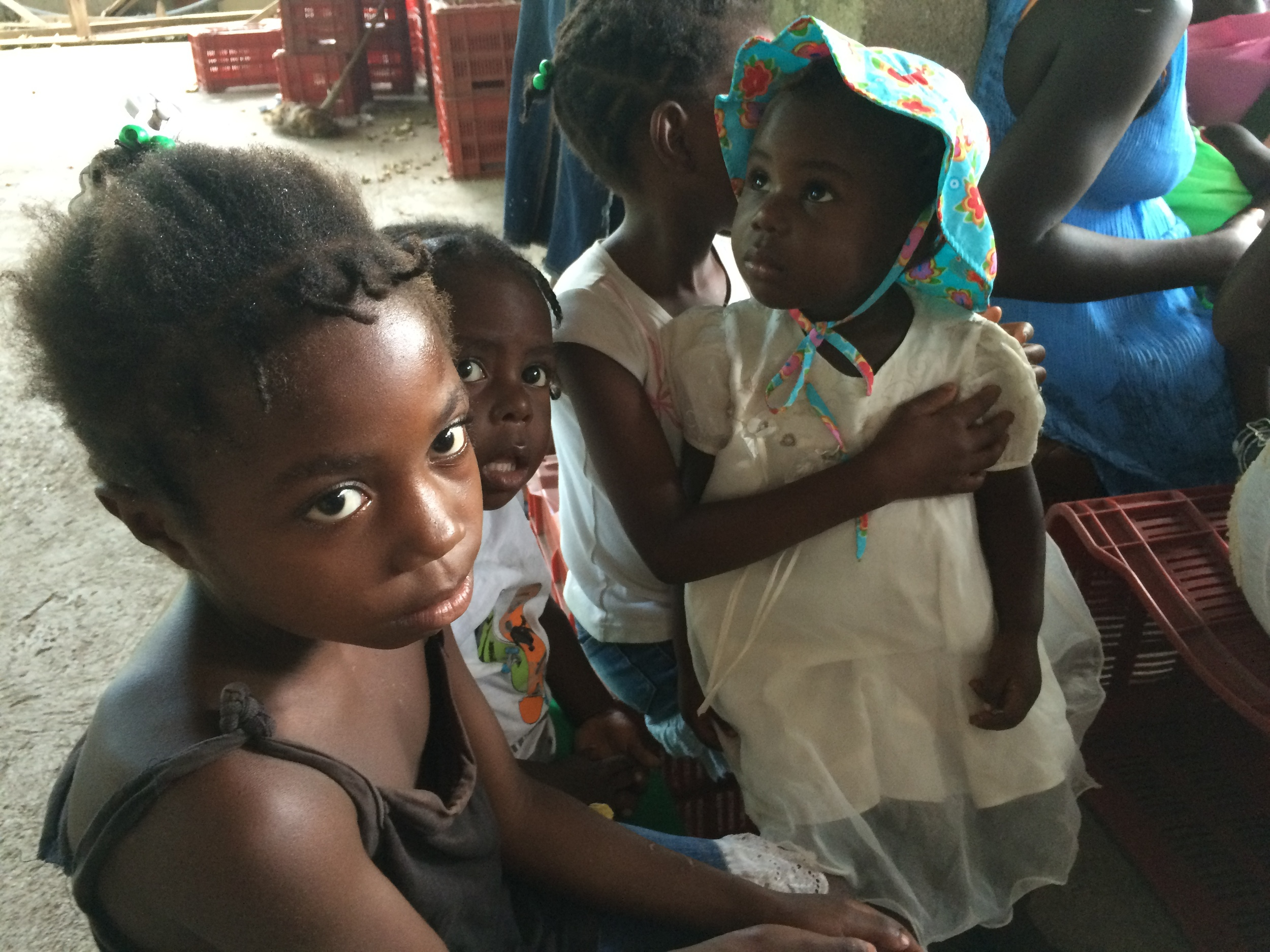 A girl listens to community health workers at a monthly community gathering in Terre Neuve, Haiti. (Laura Payton)