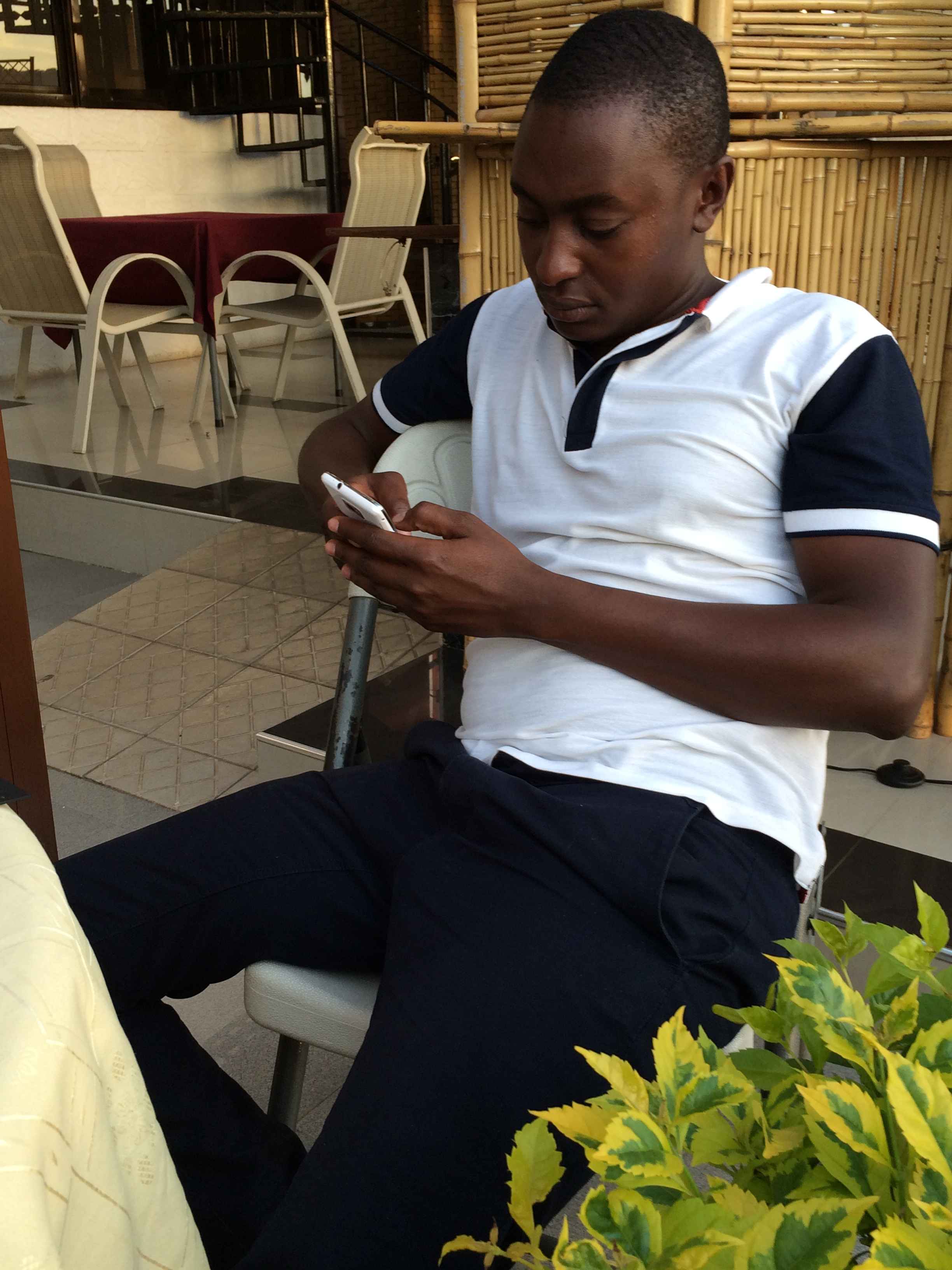 My Tanzanian fixer, Joachim, in the midst of fixing a problem for me.