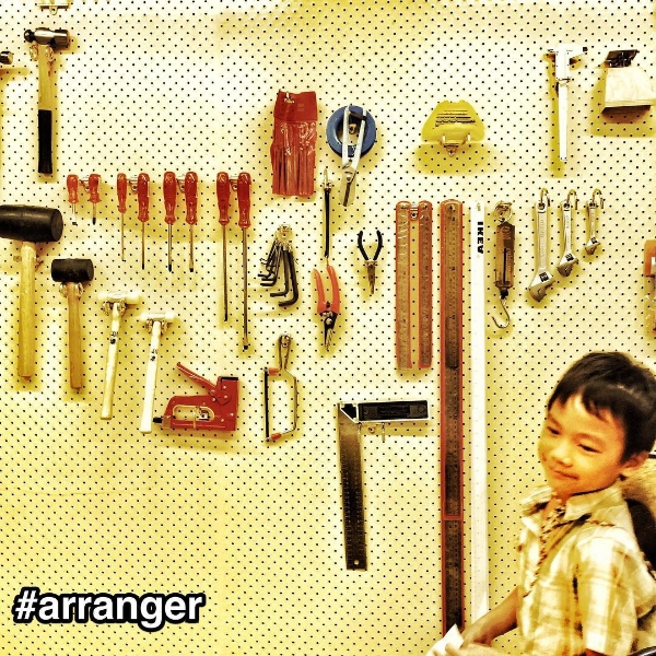 StrengthsFinder Arranger with tools on a peg board in a Singapore office