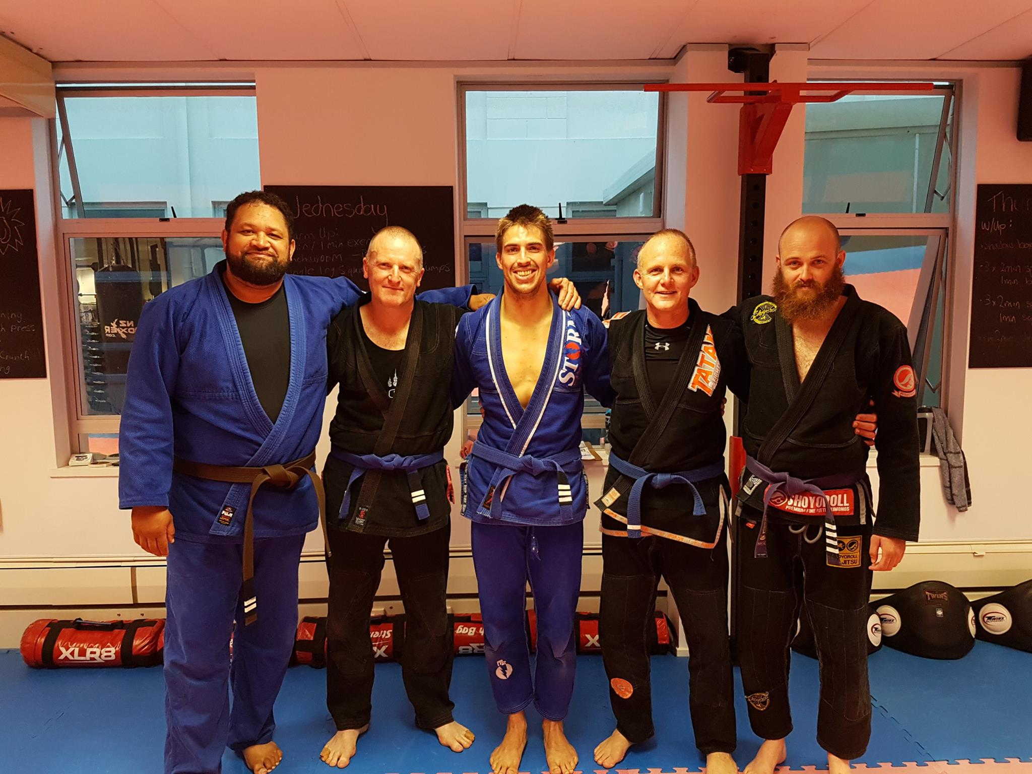 From left to right: Coach Jay, blue belts Danny, James, and Jimmy who all achieved new tabs, and Coach Andrew.