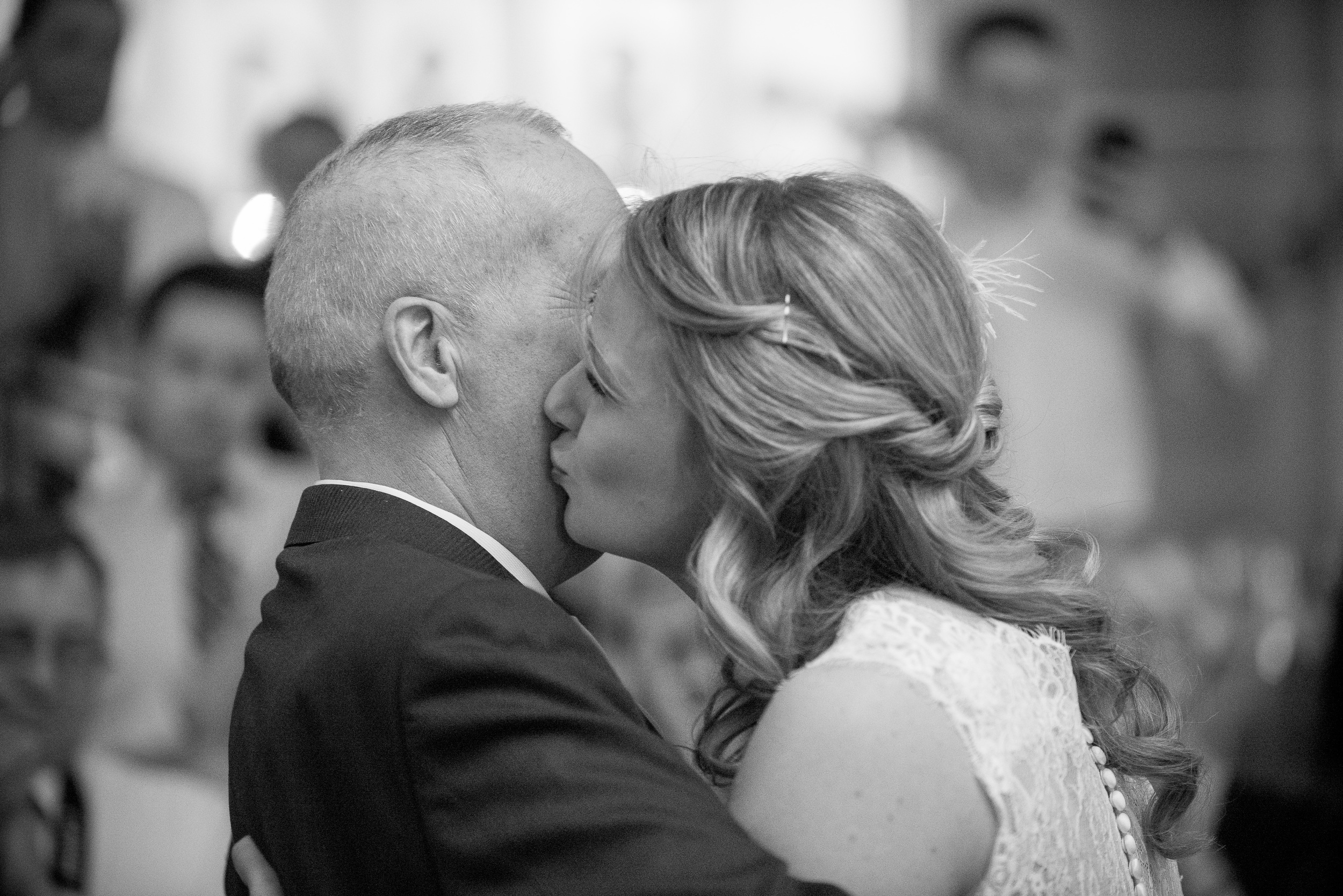 Brit and her father at her wedding. (Photo: Lindsay Coulter)