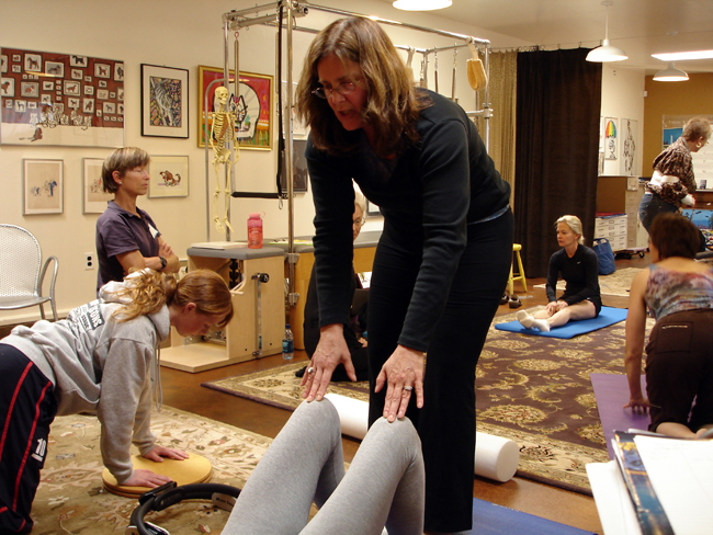 Pilates Specialist Katrina, working with Dressage riders in a Mat Pilates class.