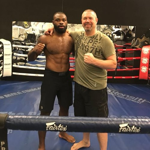 Chris training current UFC fighter, Darren 'The Dentist' Stewart (training out of MMA Clinic London).