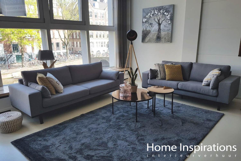 Blauw en koperkleurige woonkamer