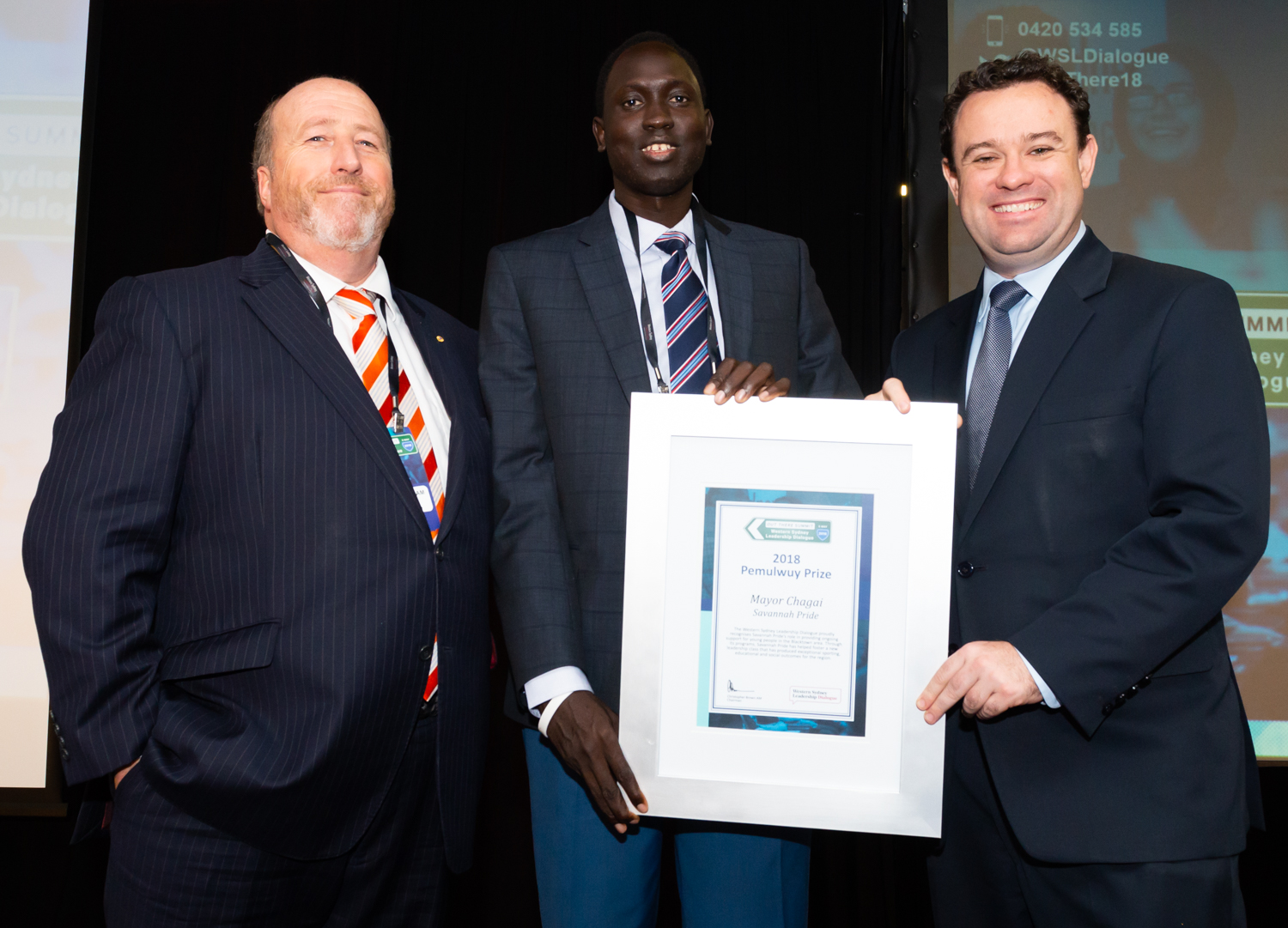 Mayor Chagai presented with the Pemulwuy Prize by Christopher Brown, Chairman of the Dialogue & Stuart Ayres, Minister for Western Sydney