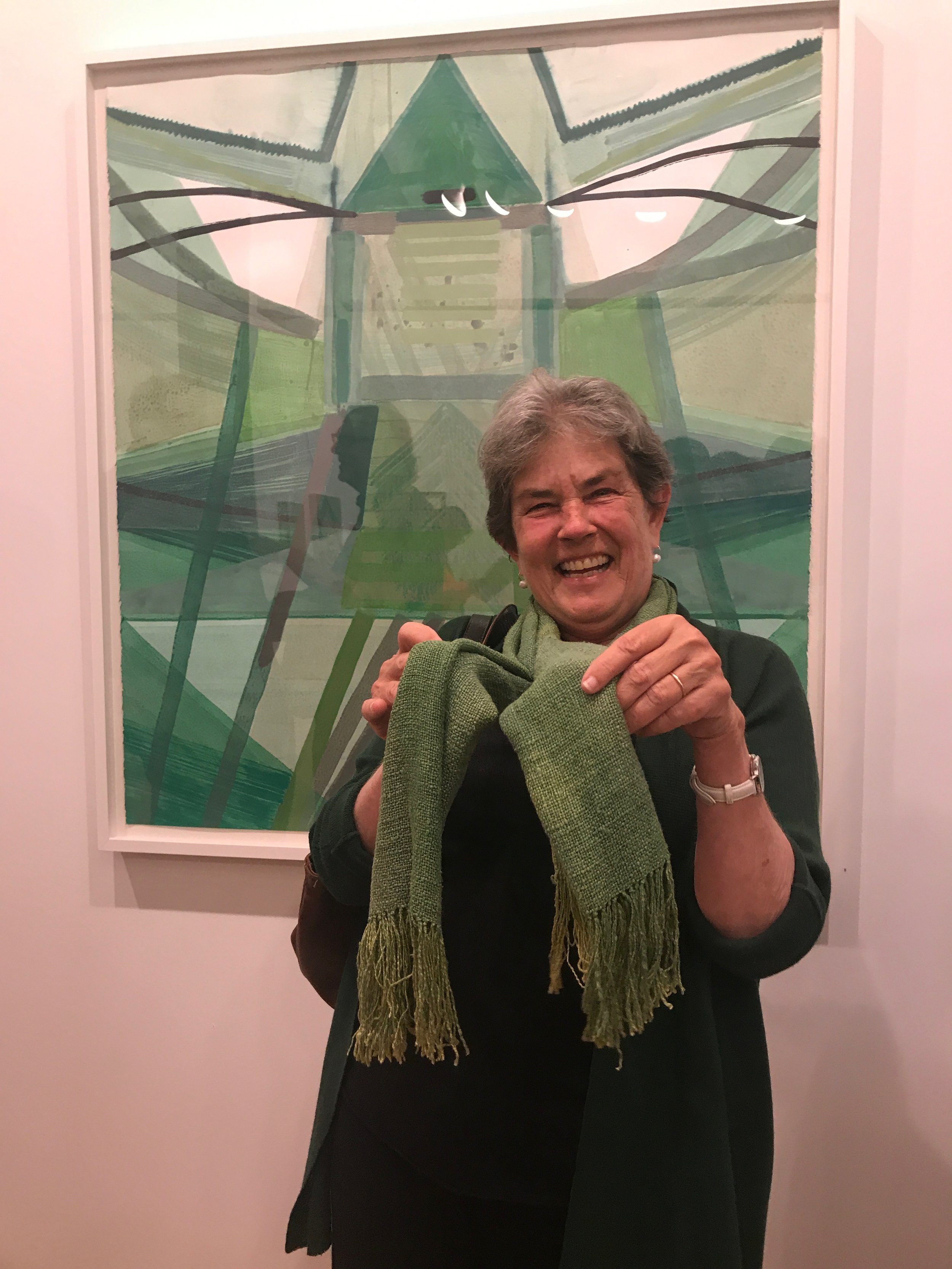 Kathy Markel in front of Ky Anderson's piece