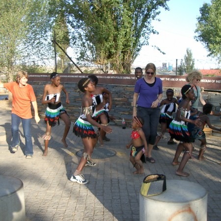 me-dancing-with-street-kids-in-soweto-teaching-them-to-say-no-to-abuse-450x450.jpg