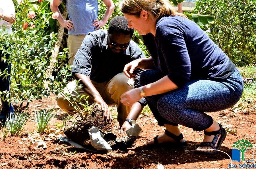 Keep Northern Ireland Beautiful Eco-Schools Coordinator, Ruth Van Ry, and Kenya Coordinator, David Wandabi, plant a tree at Samaj School, Nairobi.