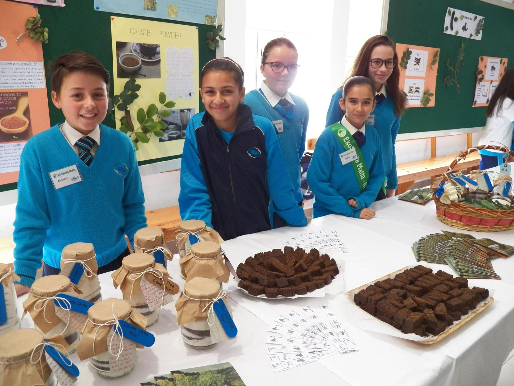 Students presenting their work during the school's Open Day - carob syrup and carob cake