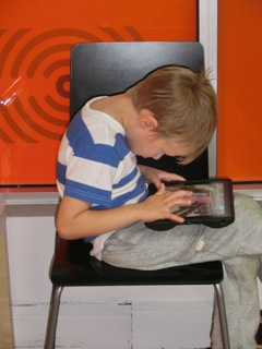 poor posture on ipad kids 2.jpg
