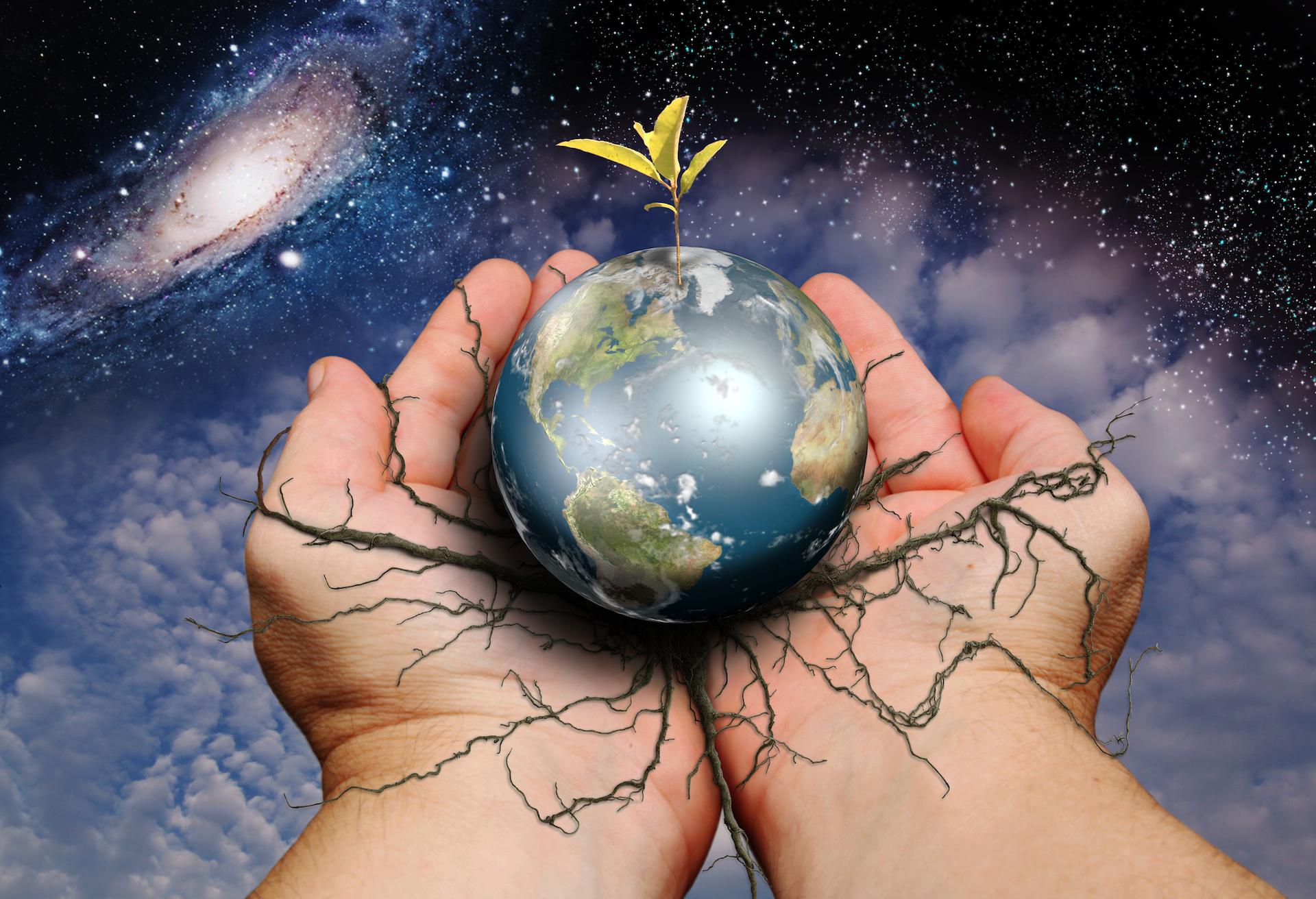 earth and cosmos in handJPG.JPG