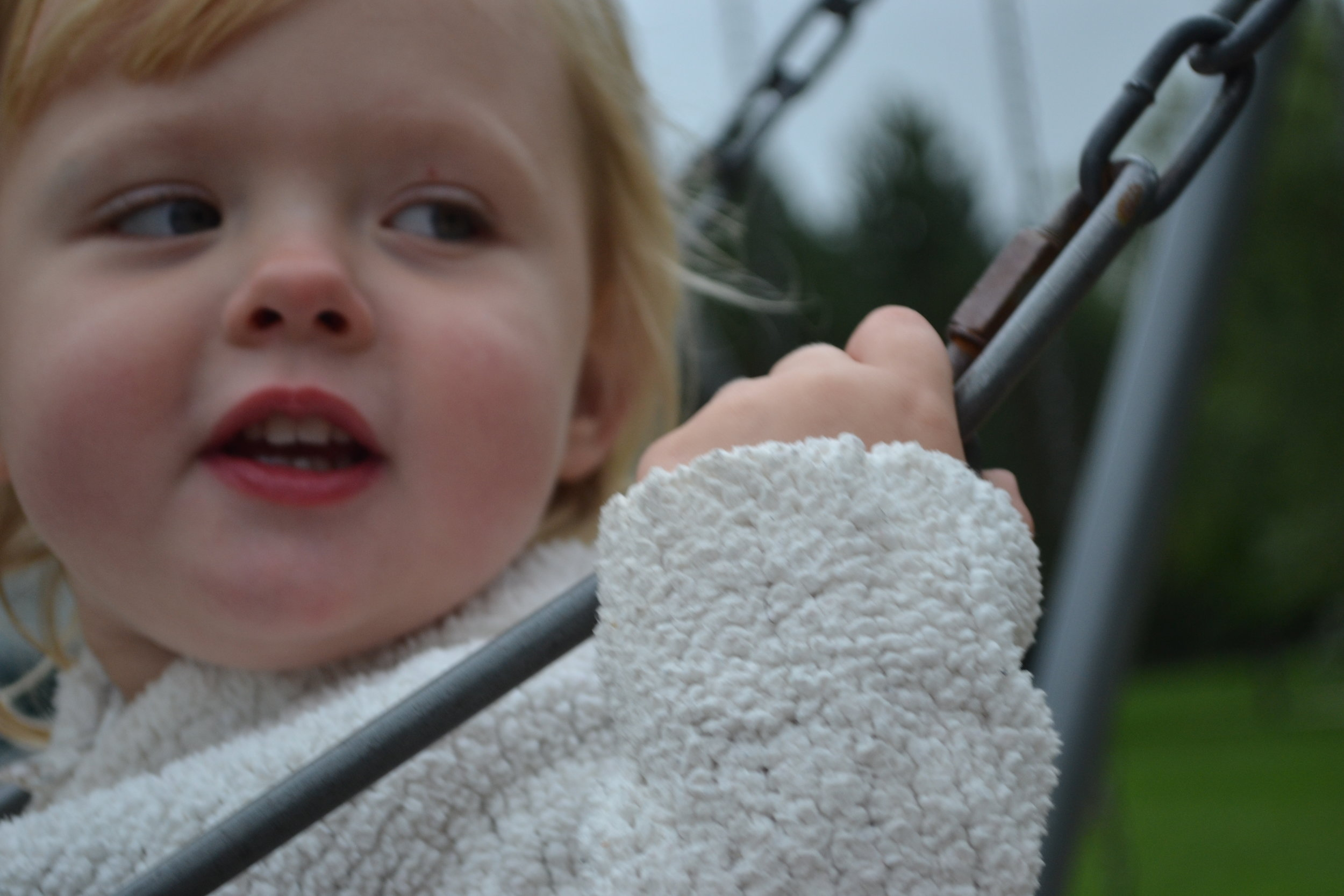 Nikon D3100. How do I get her face in focus and not her hand!!??
