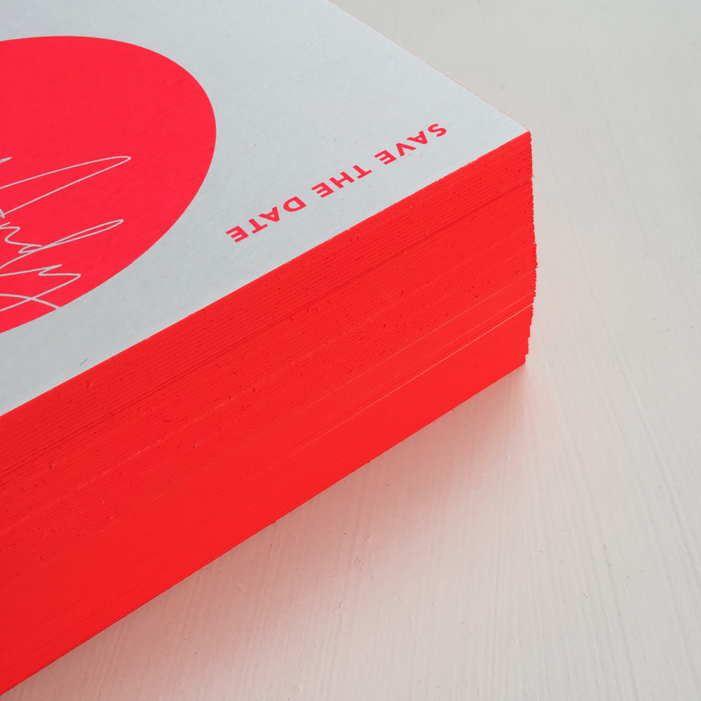 screen-printed neon save the dates