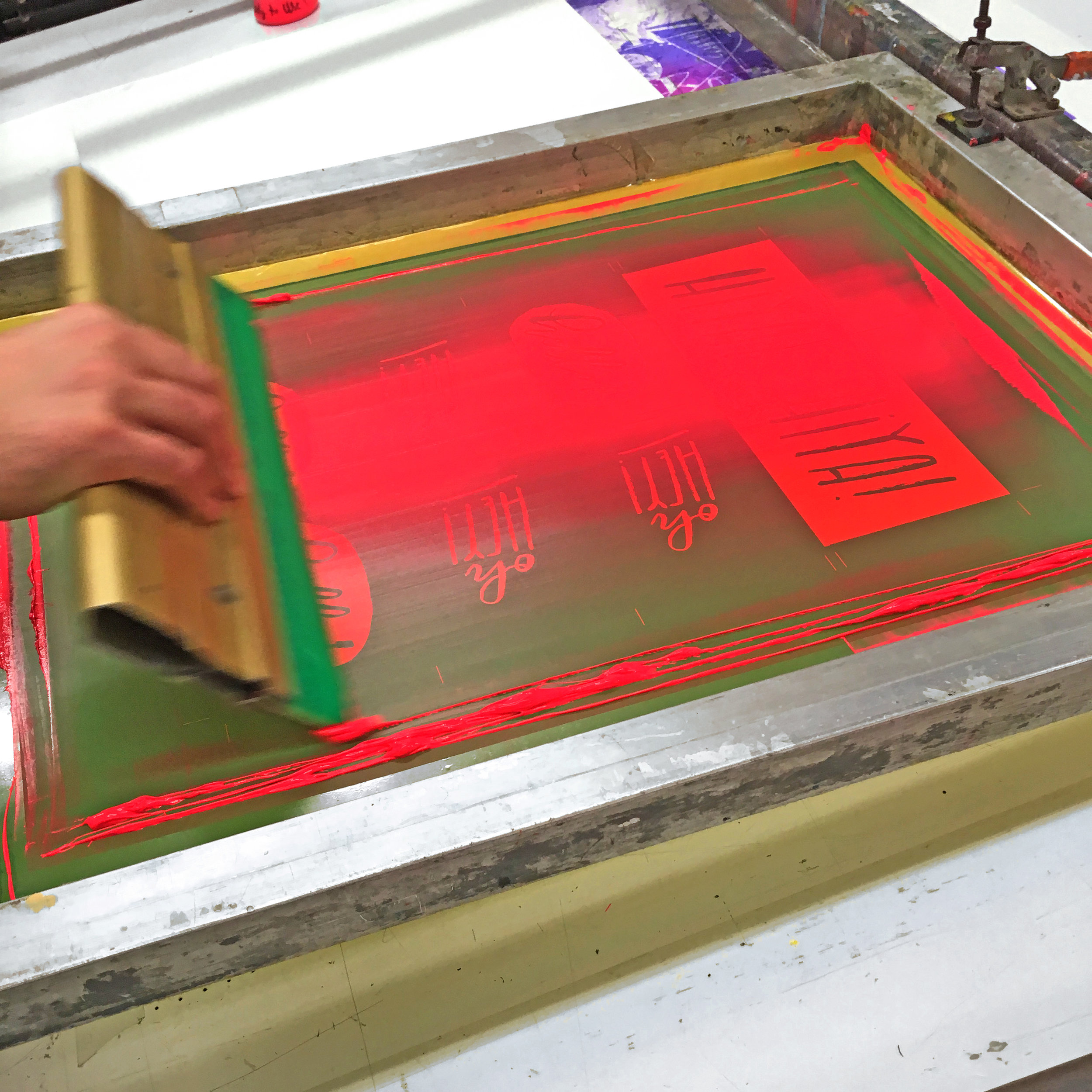 screen-printing neon ink by hand.jpg