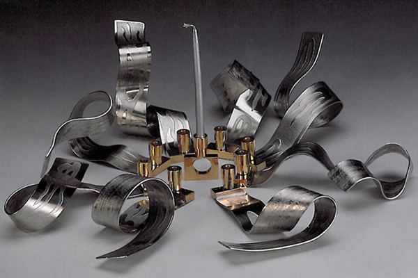 Ribbons of Light - Hanukkah Menorah  , 2000, pewter and brass, 5x18x18 inches