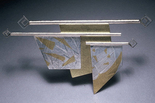 Pin  , 1985, sterling silver, 18k gold and 24k gold overlay