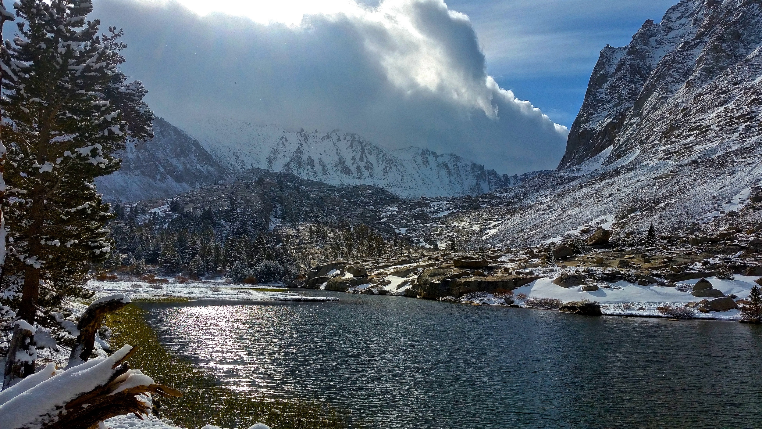 On the approach to Mt. Whitney via the John Muir Trail with a storm brewing in the background