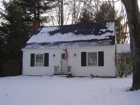 Cape style home, Ice dam, roof rake