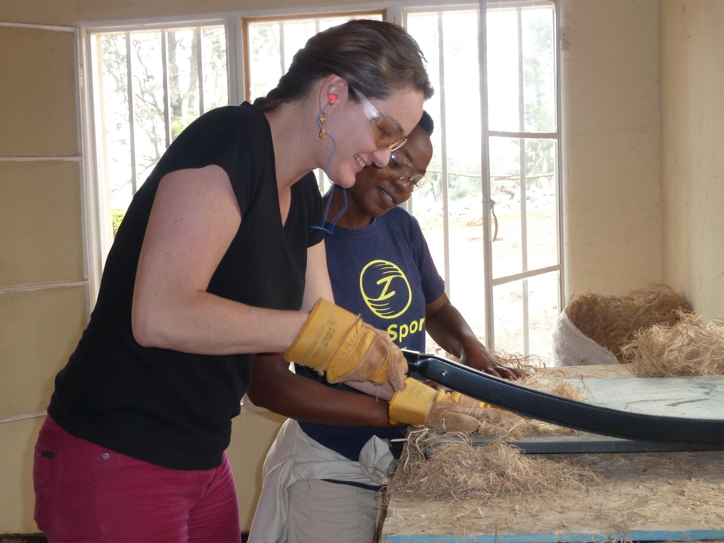 Elizabeth and a SHE staff member chopping banana fibers
