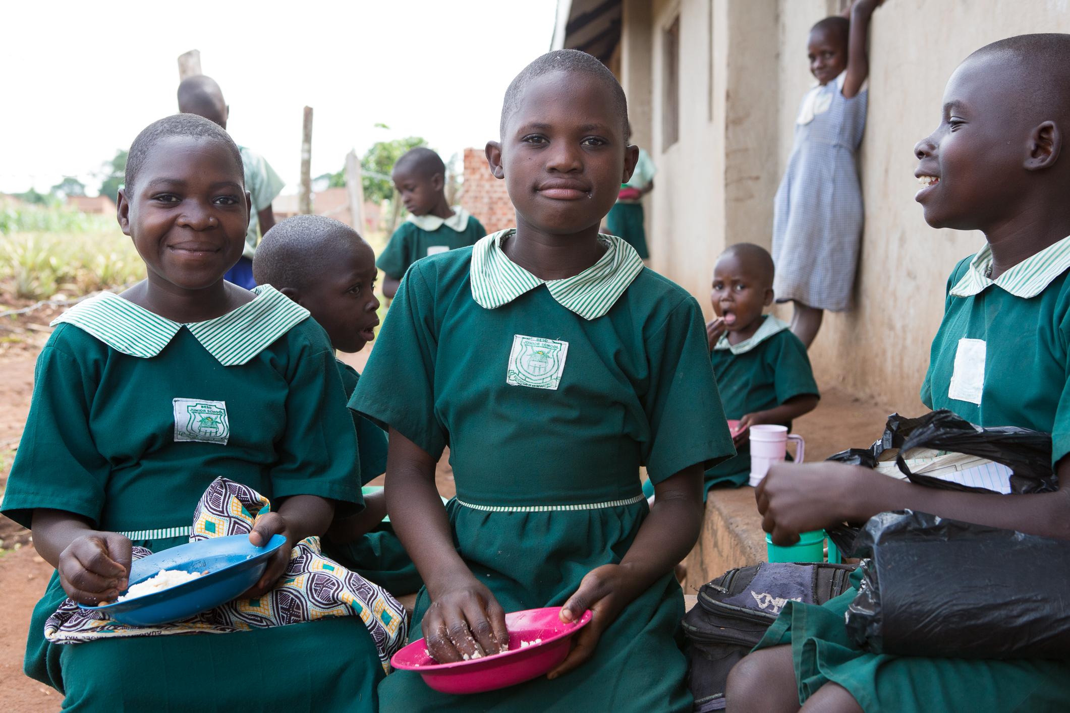 Students, Robina and Cheru, enjoying their free school lunches
