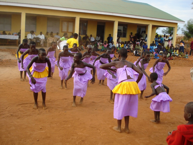 Former child soldiers dancing during peace building program