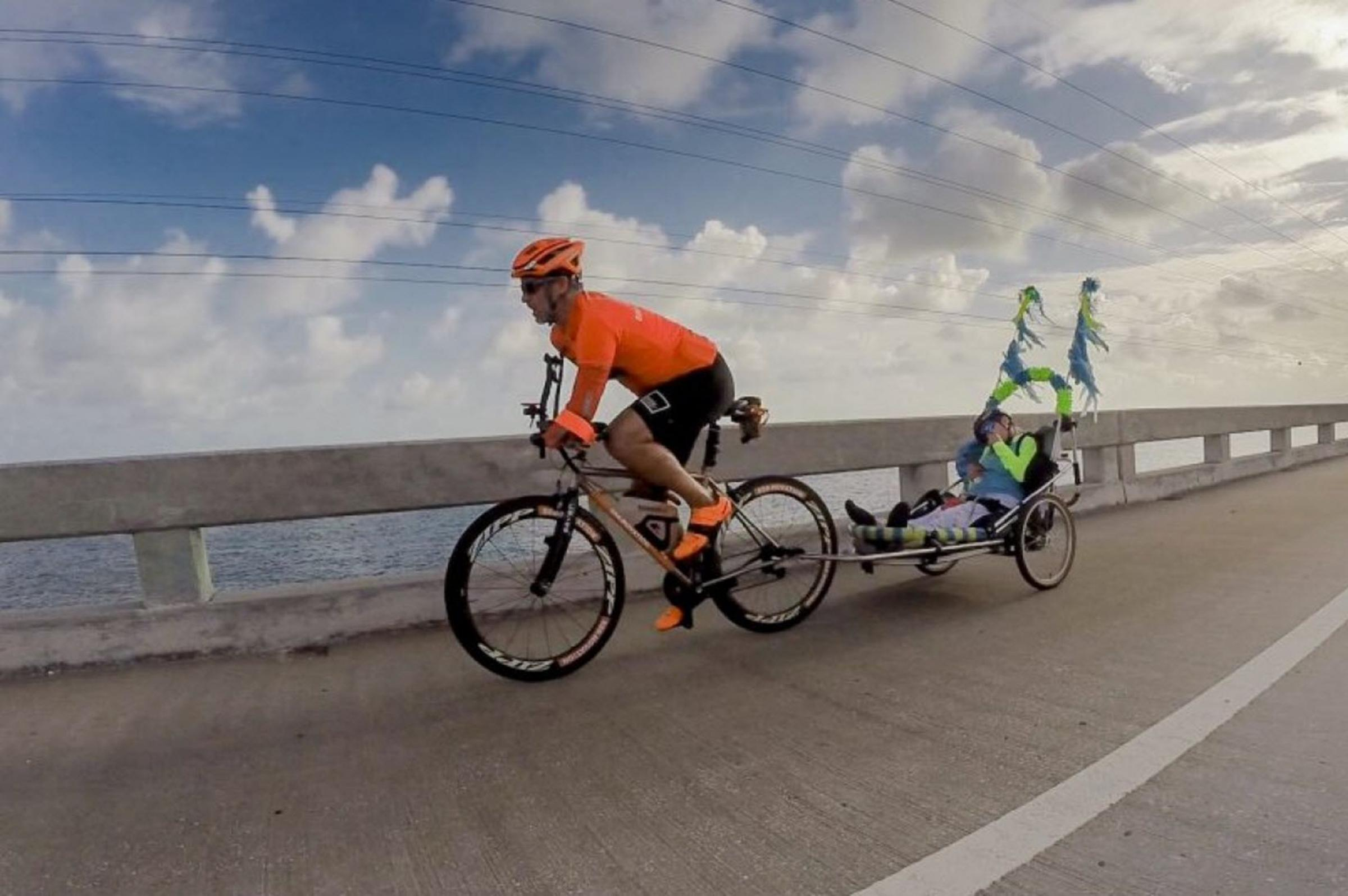 Hector and Kerry make up a dynamic racing team as they work together to complete a 50-mile cycling race through the Florida Keys