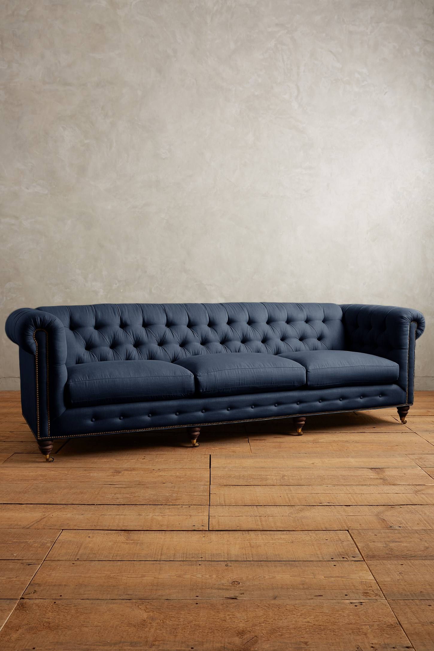 This Linen Grand Lyre Chesterfield Sofa, Hickory from  Anthropologie