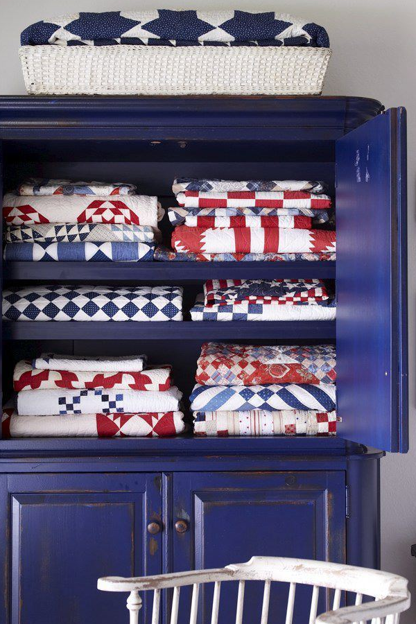 Loving these amazing textiles in a gorgeous blue armoire on  Liz Marie